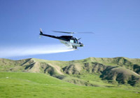 helicopter spraying fertiliser on a field